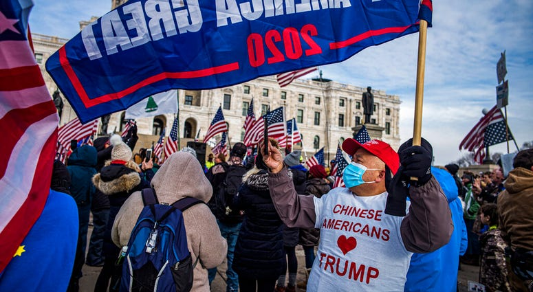 Protesters attended a rally in support of President Donald Trump on the steps of the Minnesota State Capitol on Wednesday, Jan. 6, 2021 in St. Paul, Minn.