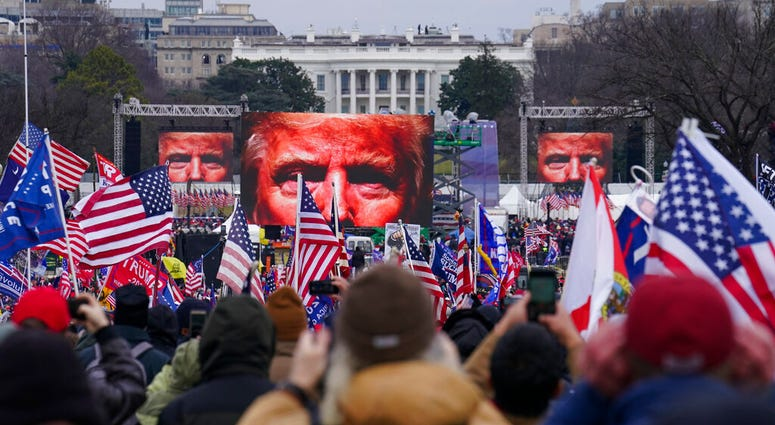 Trump supporters participate in a rally Wednesday, Jan. 6, 2021 in Washington.