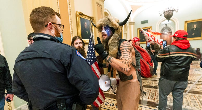 In this Jan. 6, 2021, file photo supporters of President Donald Trump are confronted by U.S. Capitol Police officers outside the Senate Chamber inside the Capitol in Washington. (AP Photo/Manuel Balce Ceneta, File)