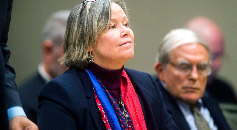 FILE - In this Dec. 7, 2018 file photo, former Michigan state medical executive Dr. Eden Wells appears in Flint, Mich. Wells, was charged.  (Jake May/The Flint Journal via AP)