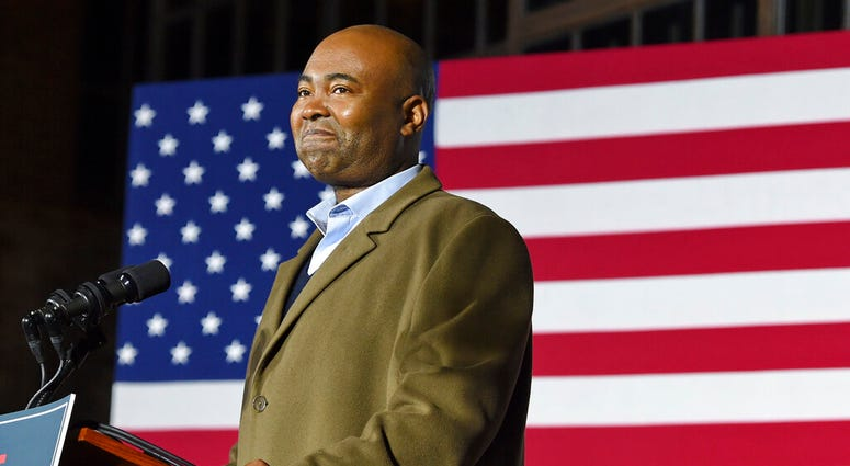 FILE - In this Nov. 3, 2020, file photo Democratic Senate candidate Jaime Harrison speaks at a watch party in Columbia, S.C., after losing the Senate race.  (AP Photo/Richard Shiro, File)