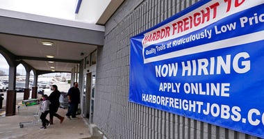 "In this Dec. 10, 2020, file photo, a ""Now Hiring"" sign hangs on the front wall of a Harbor Freight Tools store in Manchester, N.H. (AP Photo/Charles Krupa, File)"