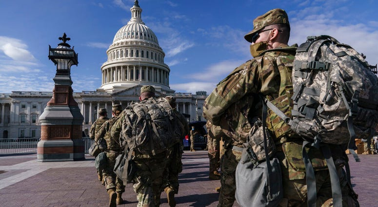 National Guard troops reinforce security around the U.S. Capitol ahead of expected protests leading up to President-elect Joe Biden's inauguration, in Washington, Sunday, Jan. 17, 2021, following the deadly attack on Congress by a mob of supporters of Pre