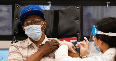 In this Jan. 15, 2021, file photo, a nursing home resident receives the COVID-19 vaccine by a CVS Pharmacist at Harlem Center for Nursing and Rehabilitation, a nursing home facility in Harlem neighborhood of New York. (AP Photo/Yuki Iwamura)