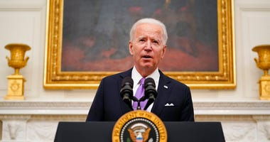President Joe Biden speaks about the coronavirus in the State Dinning Room of the White House, Thursday, Jan. 21, 2021, in Washington.