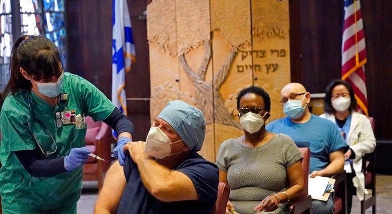 FILE - In this Dec. 30, 2020, file photo, nurse manager Rob Treiber receives a COVID-19 vaccine at Hebrew Rehabilitation Center in Boston. (AP Photo/Elise Amendola, File)