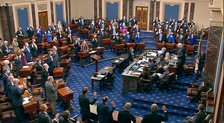 In this image from video, Sen. Patrick Leahy, D-Vt., the president pro tempore of the Senate, who is presiding over the impeachment trial of former President Donald Trump, swears in members of the Senate. (Senate Television via AP)
