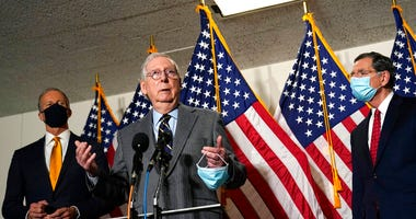 Senate Minority Leader Mitch McConnell of Ky., center, flanked by Sen. John Thune, R-S.D., left, and Sen. John Barrasso, R-Wyo., right, speaks during a news conference on Capitol Hill in Washington, Tuesday, Jan. 26, 2021. (AP Photo/Susan Walsh)