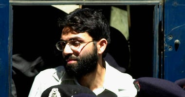 FILE - In this March 29, 2002 file photo, Ahmed Omar Saeed Sheikh, the alleged mastermind behind Wall Street Journal reporter Daniel Pearl's kidnap-slaying, appears at the court in Karachi, Pakistan.