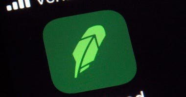 FILE - This Dec. 17, 2020 file photo shows the logo for the Robinhood app on a smartphone in New York.