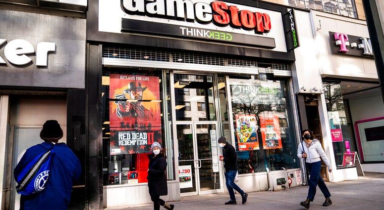 FILE - Pedestrians pass a GameStop store on 14th Street at Union Square, Thursday, Jan. 28, 2021, in the Manhattan borough of New York. (AP Photo/John Minchillo, File)