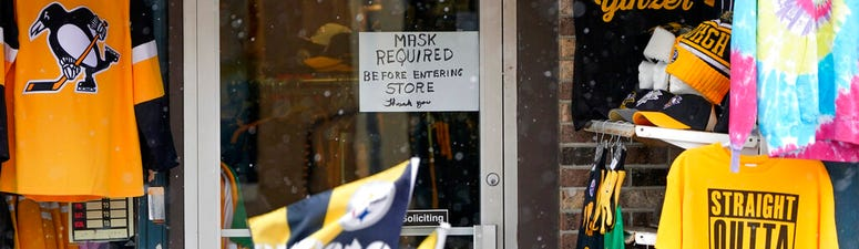 A sign requiring patrons to wear a mask is on the door to Whitey's General Store in Zelienople, Pa., Thursday, Jan. 28, 2021.