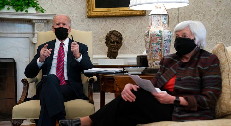 President Joe Biden meets with Treasury Secretary Janet Yellen in the Oval Office of the White House, Friday, Jan. 29, 2021, in Washington. (AP Photo/Evan Vucci)