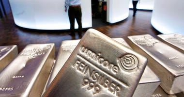 FILE - In this file photo dated Wednesday, May 9, 2007, Silver bullion, bars weighing five kilograms each, are displayed in the trading room of the stock exchange in Frankfurt, Germany.