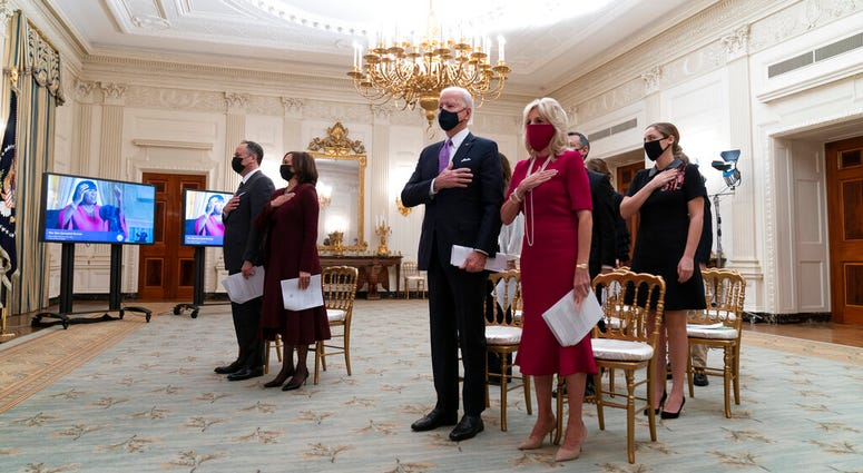 FILE - In this Jan. 21, 2021, file photo, Doug Emhoff, left, Vice President Kamala Harris, President Joe Biden, and first lady Jill Biden, stand during a performance of the National Anthem.  (AP Photo/Alex Brandon)
