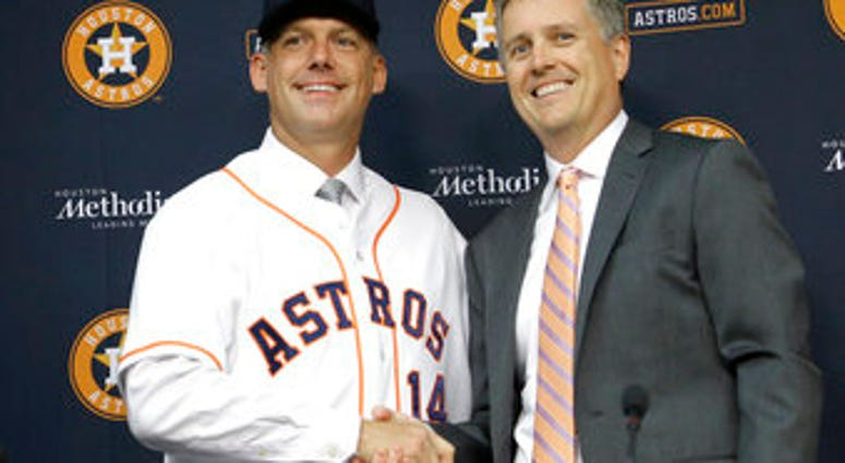 FILE - In this Sept. 29, 2014, file photo, Houston Astros general manager Jeff Luhnow, right, and A.J. Hinch pose after Hinch is introduced as the new manager of the baseball club in Houston. (AP Photo/Pat Sullivan, File)