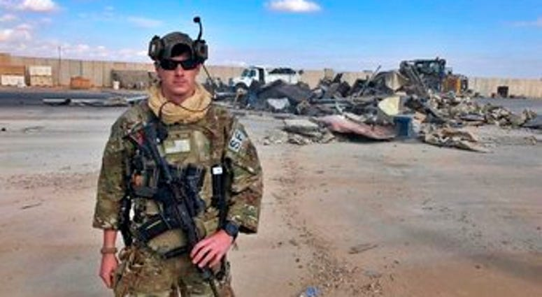 A U.S. soldier stands while bulldozers clear rubble and debris at Ain al-Asad air base in Anbar, Iraq, Monday, Jan. 13, 2020. Ain al-Asad air base was struck by a barrage of Iranian missiles last week. (AP Photo/Ali Abdul Hassan)