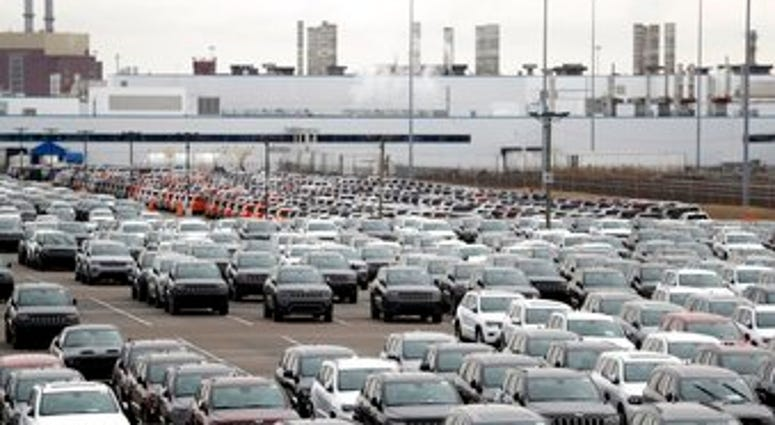 FILE - In this Feb. 26, 2019, file photo, Jeep vehicles are parked outside the Jefferson North Assembly Plant in Detroit. (AP Photo/Carlos Osorio, File)