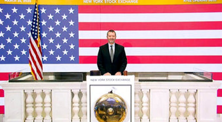 In this photo taken from video provided by the New York Stock Exchange, Director of Facilities & Building Operations James Katsarelis rings the opening bell at the NYSE, on Wednesday, March 25, 2020.  (New York Stock Exchange via AP)