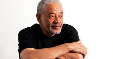 FILE - In this June 21, 2006 file photo, singer-songwriter Bill Withers poses in his office in Beverly Hills, Calif. (AP Photo/Reed Saxon, File)