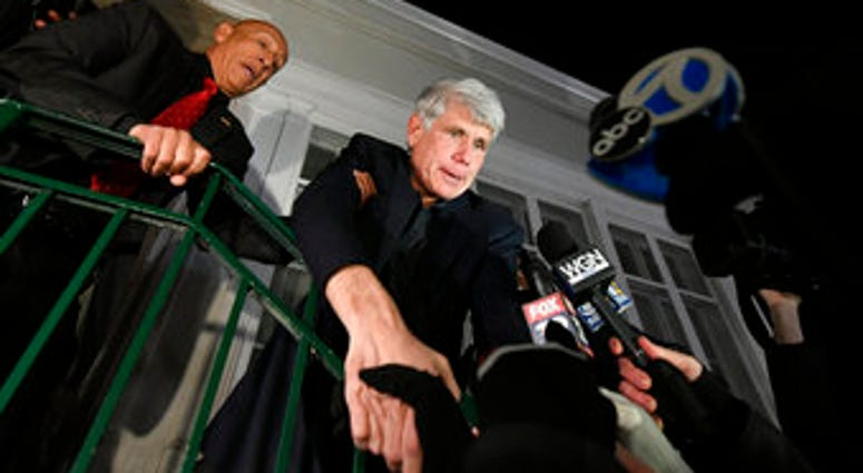 Former Illinois Gov. Rod Blagojevich shakes hands with a supporter as he arrives home in Chicago on Wednesday, Feb. 19, 2020, after his release from Colorado prison late Tuesday. (AP Photo/Paul Beaty)
