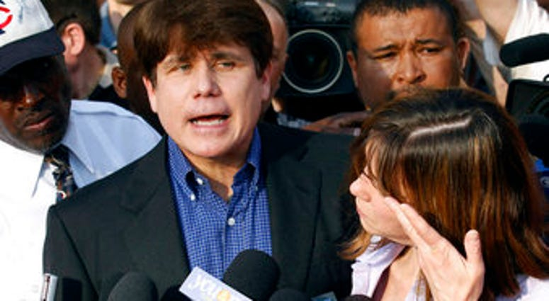 FILE - In this March 14, 2012, file photo, former Illinois Gov. Rod Blagojevich speaks to the media outside his home in Chicago a day before reporting to prison after his conviction on corruption charges. (AP Photo/M. Spencer Green, File)