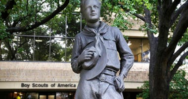 In this Wednesday, Feb. 12, 2020, photo, a statue stands outside the Boys Scouts of America headquarters in Irving, Texas. The Boy Scouts of America has filed for bankruptcy protection as it faces a barrage of new sex-abuse lawsuits. (AP Photo/LM Otero)