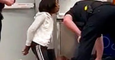 In this March 23, 2020 frame grab taken from video, Marvia Gray, is seen on her knees, while her son Derek Gray is seen face down as they are arrested at a Sam's Club store in Des Peres, Missouri. ( Photo courtesy Action Injury Law Group via AP)