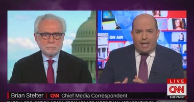 Brian Stelter and Wolf Blitzer