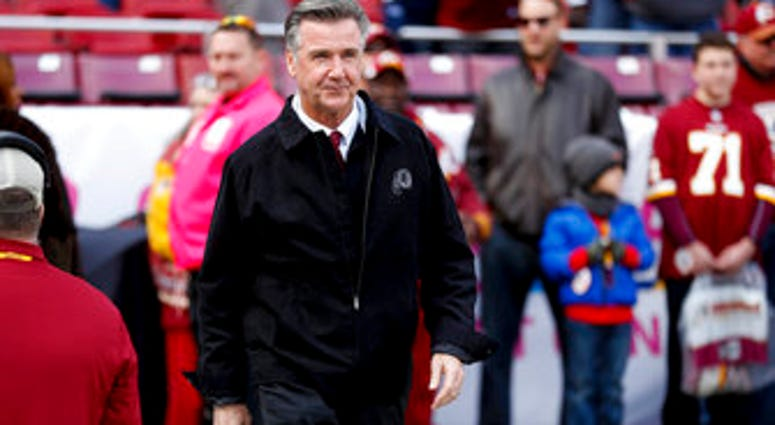 FILE - In this Oct. 21, 2018 file photo, Washington Redskins President Bruce Allen walks across the field before an NFL football game against the Dallas Cowboys in Landover, Md.  (AP Photo/Andrew Harnik, File)