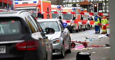 Emergency cars stand next to the scene of the accident with a car that is said to have crashed into a carnival parade in Volkmarsen, central Germany, Monday, Feb. 24, 2020. (Uwe Zucchi/dpa via AP)