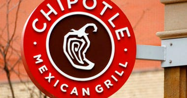 FILE - This Jan. 12, 2017, file photo shows the sign on a Chipotle restaurant in Pittsburgh. (AP Photo/Gene J. Puskar, File)