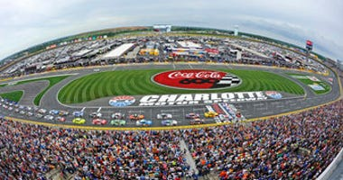 FILE - In this May 27, 2018, file photo, the field takes the green flag to start the NASCAR Cup Series auto race at Charlotte Motor Speedway in Concord, N.C. (AP Photo/Mike McCarn, file)
