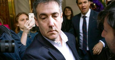 FILE - In this May 6, 2019, file photo, Michael Cohen, former attorney to President Donald Trump, leaves his apartment building before beginning his prison term in New York. (AP Photo/Kevin Hagen, File)