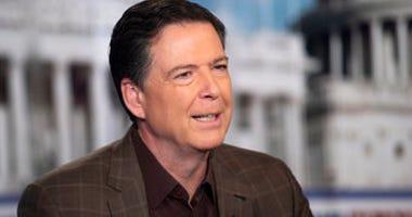 "Former FBI Director James Comey talks with ""Fox News Sunday"" anchor Chris Wallace, Sunday morning, Dec. 15, 2019, in Washington. (AP Photo/Kevin Wolf)"