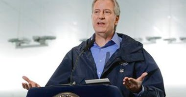 FILE - In this March 31, 2020 file photo, New York City Mayor Bill de Blasio speaks at the USTA Indoor Training Center where a 350-bed temporary hospital will be built in New York. (AP Photo/Frank Franklin II, File)