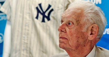FILE - In this June 28, 2012, file photo, New York Yankees great Don Larsen reacts during a news conference announcing the auction of his 1956 perfect game uniform, in New York. (AP Photo/Bebeto Matthews, File)