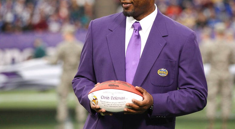 FILE - In this Dec. 15, 2013, file photo, former Minnesota Viking Chris Doleman acknowledges the crowd during a ceremony honoring the All Mall of America Field team during halftime of an NFL football game. (AP Photo/Andy King, File)