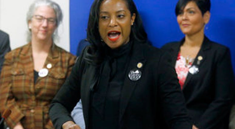 FILE - Jan. 22, 2019 file photo, Del. Jennifer Carroll Foy, D-Prince William, center, speaks during a news conference of ERA supporters after her bill was killed by a House subcommittee. (Bob Brown/Richmond Times-Dispatch via AP)