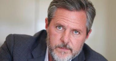 FILE - In this Nov. 16, 2016, file photo, Liberty University president Jerry Falwell Jr., poses during an interview in his offices at the school in Lynchburg, Va. (AP Photo/Steve Helber, File)
