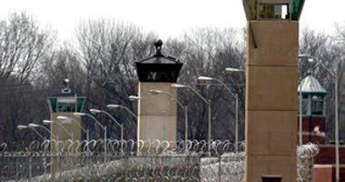 FILE - In this March 17, 2003 file photo, guard towers and razor wire ring the compound at the U.S. Penitentiary in Terre Haute, Ind., the site of the last federal execution. (AP Photo/Michael Conroy, File)