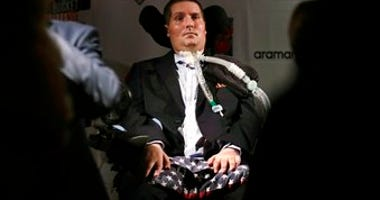 FILE - In this Sept. 18, 2017 photo, Pete Frates, who is stricken with amyotrophic lateral sclerosis, or ALS, listens to a guest at Fenway Park in Boston. (AP Photo/Charles Krupa, File)