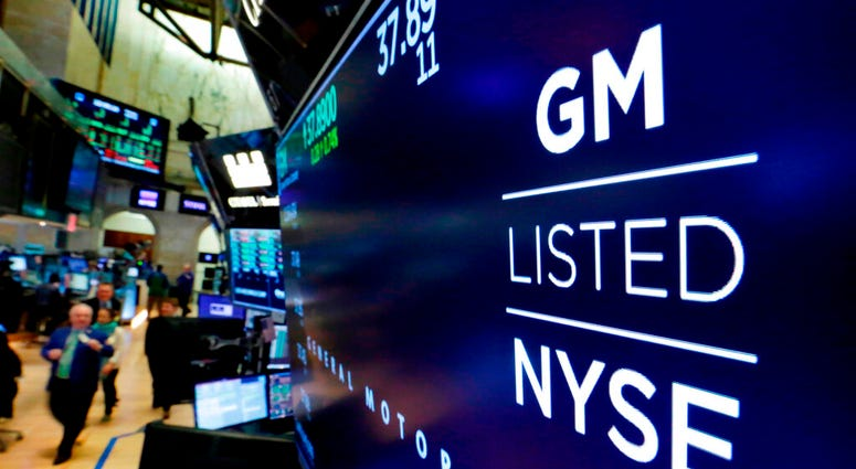 FILE - In this April 23, 2018, file photo, the logo for General Motors appears above a trading post on the floor of the New York Stock Exchange.  (AP Photo/Richard Drew, File)