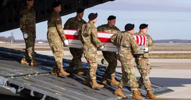 FILE - In this Dec. 25, 2019, file photo, an Army carry team moves a transfer case containing the remains of U.S. Army Sgt. 1st Class Michael Goble, at Dover Air Force Base, Del. (AP Photo/Alex Brandon, File)