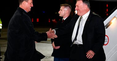 Secretary of State Mike Pompeo is greeted by U.S. ambassador to Germany Richard Grenell as he arrives at Munich International Airport, in Munich, Germany on Thursday, February 13, 2020. (Andrew Caballero-Reynolds/Pool via AP)