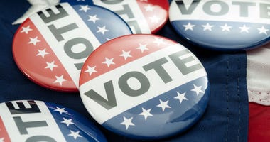 Vote election campaign button badges and the united states of american flag