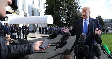 President Donald Trump reporters