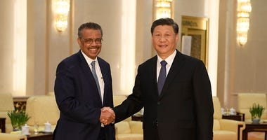 Xi Jinping and Tedros Adhanom