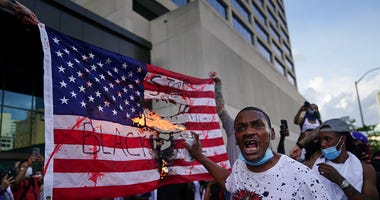 Black Lives Matter protesters burn American flag