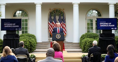 President Donald Trump and reporters in Rose Garden